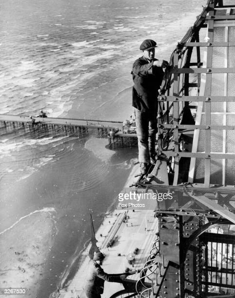 Workmen fix lamps on Blackpool's famous Tower ready for the big switchon The finished product would contain nearly 300 tons of electrical fitments...
