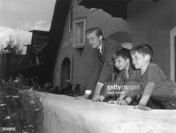 Writer Ernest Hemingway's three sons lean on a wall Idaho From left to right Jack 'John' Patrick 'Mouse' and Gregory 'Gigi' Hemingway