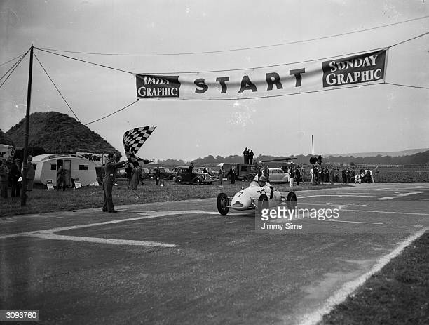 British motorracing driver Stirling Moss winning the race for midget racing cars on the Goodwood Estate in a Cooper car
