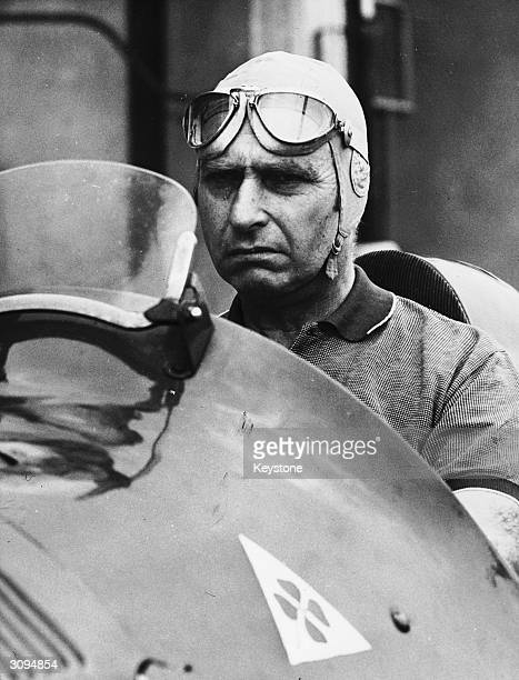 Racing driver Juan Fangio behind the wheel of the Alfetta 159 Alfa Romeo in which he won the 1951 World Championship He is on the famous Monza racing...