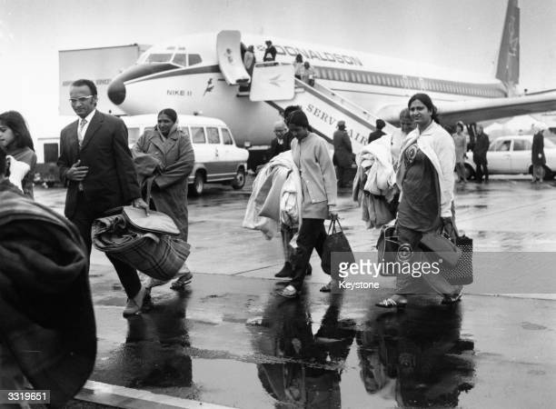 Ugandan Asians arrive at Stansted Airport on the first of several specially chartered flights to Britain shortly after Ugandan military dicatator Idi...