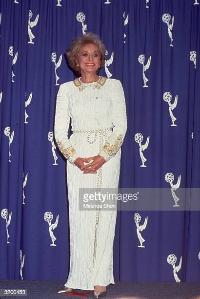 Barbara Walters, American broadcast news anchor and television host poses for photographers at the Pasadena Civic Auditorium during the Emmy Award...