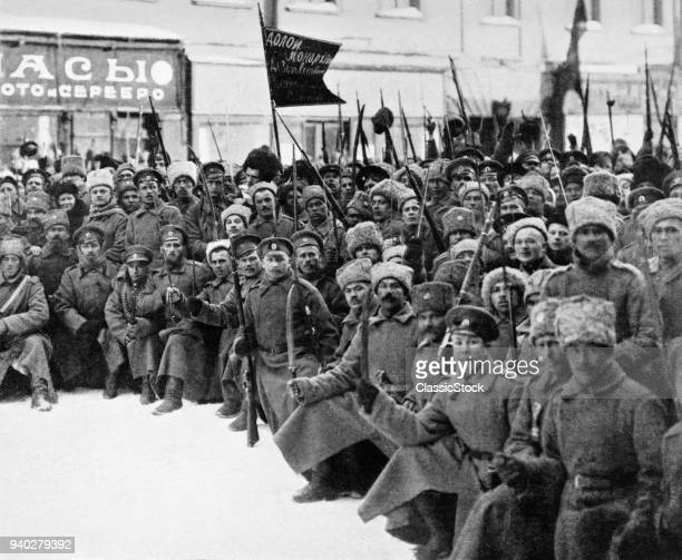 1900s 1917 SIBERIAN RIFLES AND COSSACKS TROOPS WITH SIGNS DOWN WITH MONARCHY ON WAY TO DUMA IN PETROGRAD ST PETERSBURG RUSSIA