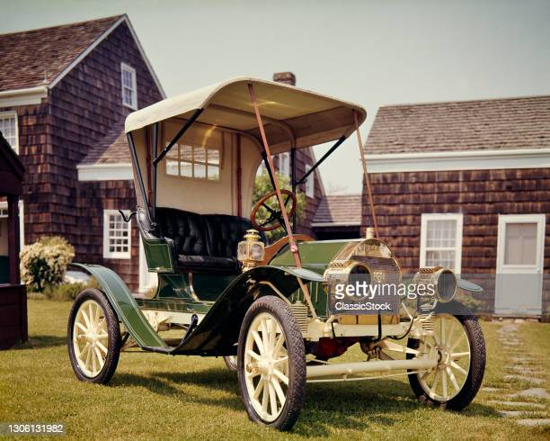 1900s Antique 1909 Buick Two seat Canvas Top Wood spoke Wheel Brass Headlamps Automobile Painted Green And Cream .