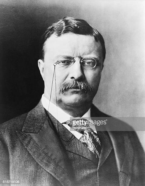 1905Head and shoulders portrait of President Theodore Roosevelt wearing a suit and spectacles