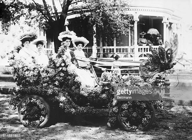 Four young ladies in flower decorated automobile for the Floral Parade at Mardi Gras Photograph 1905 in Mobile AL