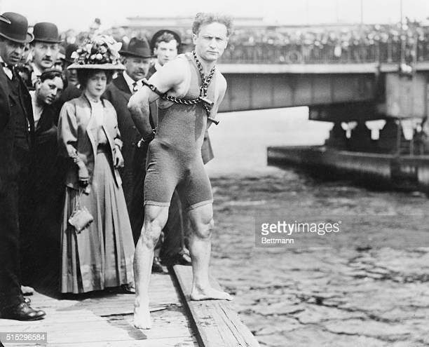 Harry Houdini chained up ready to jump into Charles River Boston