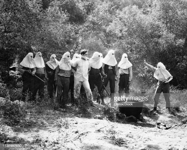 1910s 1920s KU KLUX KLAN POSSE WITH PRISONER ABOUT TO BE TARRED AND FEATHERED SILENT MOVIE STILL THE BIRTH OF A NATION