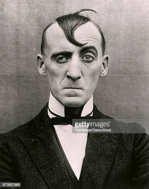 1910s MAN WITH FUNNY FACE AND HAIRSTYLE EARLY SILENT FILM STILL