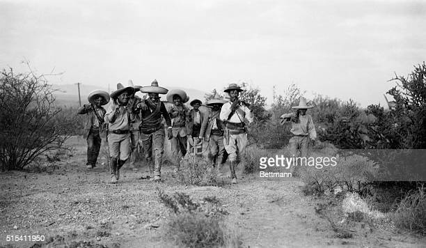 Mexican Revolution of 1913 Photo shows Pancho Villa's troops walking through bushy terrain