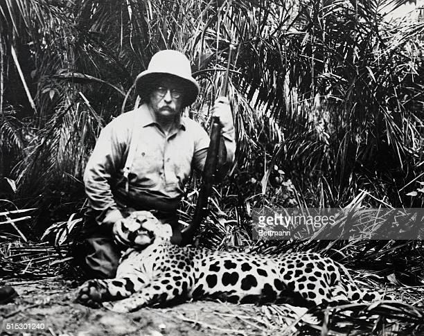 1913Theodore Roosevelt kneeling beside a slain jaguar during hunt on the Rio Taquari Brazil