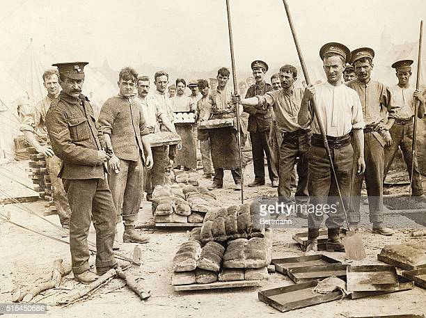 1915Flanders Netherlands A British field bakery photo shows bakers and troops with bread tents in background World War I photograph