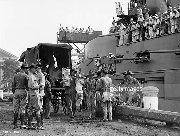 Marines taking provisions and supplies on board the U S S Conneticut at League Island Philadelphia July 31 when 500 Marines sailed to PortauPrince...