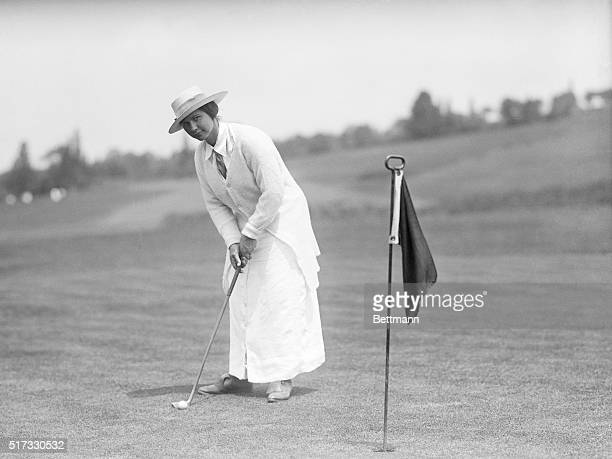 Women-Golf. Woman about to take a swing with golf club.