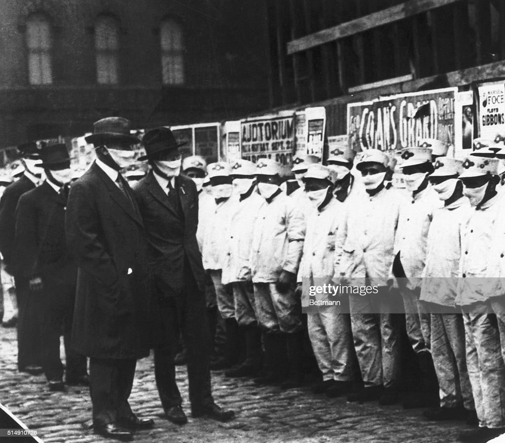 Chicago, Illinois- Inspecting Chicago street cleaners for Spanish influenza. Officials are wearing gauze masks.