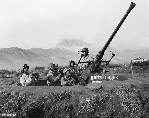 An American antiaircraft battery is manned entirely by Negro soldiers near the front lines above Venafar Italy Front row left to right Pvt George H...