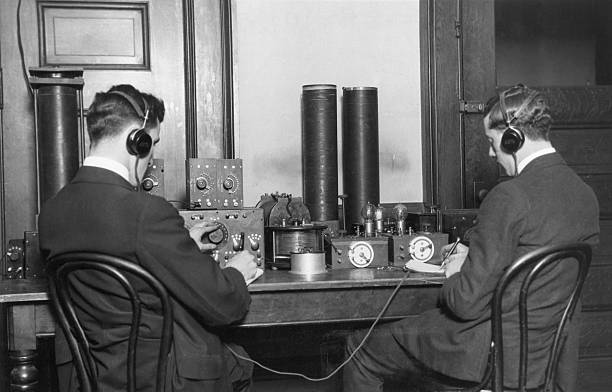Early radio ham operators trying to make contact with other members of the fraternity.