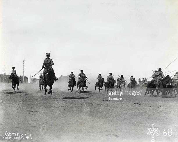 Siberia, Russia: White Russian troops advance on horseback during the Civil War.