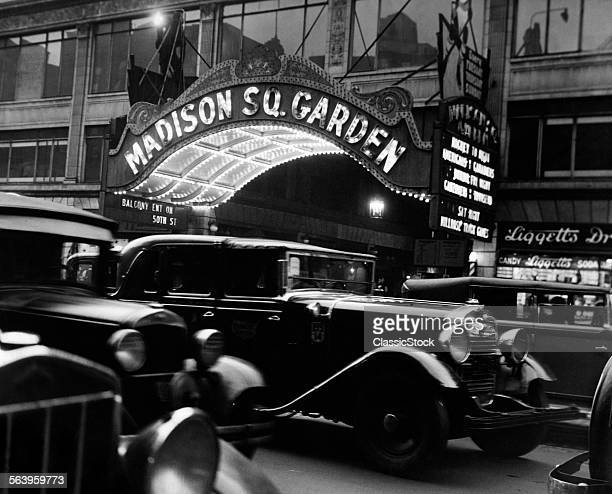 1920s 1930s CARS TAXIS MADISON SQUARE GARDEN MARQUEE AT NIGHT MANHATTAN NEW YORK CITY USA