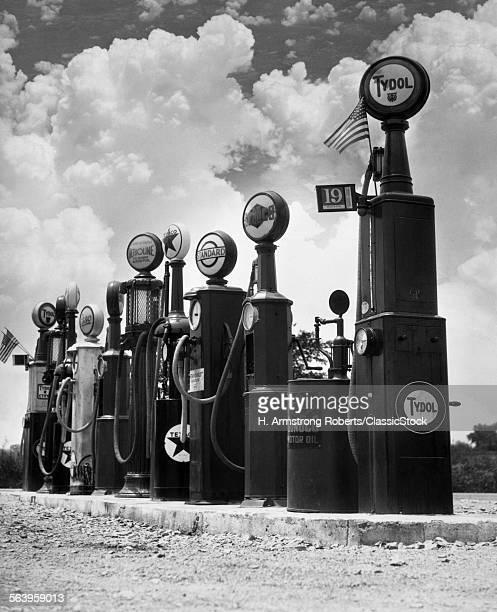 1920s 1930s LINE OF GASOLINE PUMPS