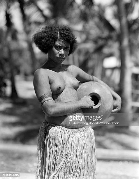1920s 1930s SERIOUS UNSMILING PORTRAIT TOPLESS PAPUAN GIRL NATIVE IN GRASS SKIRT NEW GUINEA