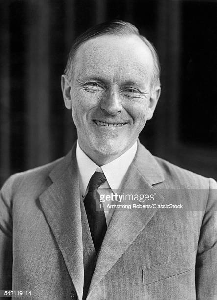 1920s 1930s SMILING PORTRAIT OF CALVIN COOLIDGE 30th AMERICAN PRESIDENT LOOKING AT CAMERA