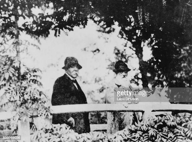 French politician Georges Clemenceau and his friend Claude Monet famous impressionist painter in Monet's garden in Giverny France 1920s On the right...