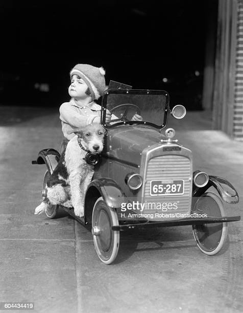 1920s GIRL IN TOY PEDAL.