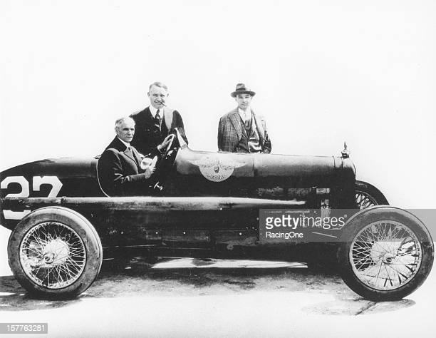 """Henry Ford , Barney Oldfield and Ford's son Edsel Ford pose with a Ford-powered AAA """"Big Car."""" in the 1920s. Oldfield raced many of Henry Ford's..."""