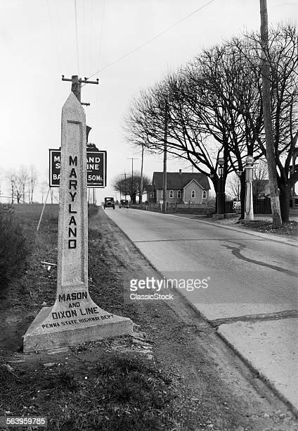 1920s LOOKING NORTH PAST OBELISK HIGHWAY MARKER SIGN MARYLAND AND PENNSYLVANIA BORDER MARKING MASON DIXON LINE