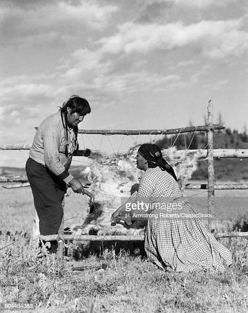 1920s NATIVE AMERICAN AN COUPLE MAN & WOMAN TREATING ANIMAL HIDE SKIN STONEY SIOUX ALBERTA CANADA