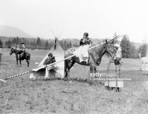 1920s NATIVE AMERICAN SIOUX FAMILY WOMAN MOTHER CHILDREN BY TEPEE GIRL DAUGHTER ON HORSEBACK