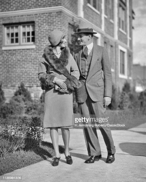 1920s SMILING COUPLE MAN...