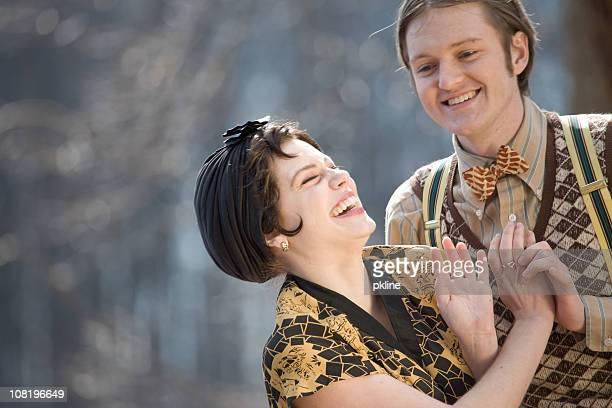 1920s style couple having fun