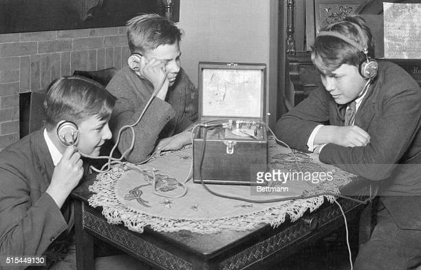 1921Boys then as now were enthusiastic fans Here a trio listens to an early radio program 1921