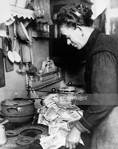 1923Berlin Germany A German housewife is shown in the act of lighting the fire for the breakfast meal with several million German marks It is cheaper...