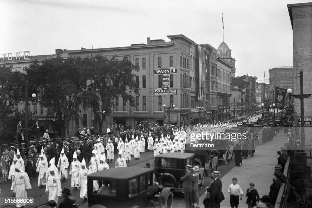 Ku Klux Klan demonstration Photo shows line of Klansmen parading down street