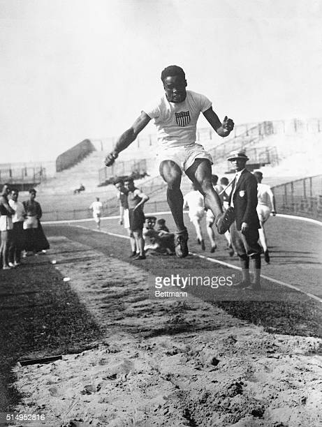 Paris, France- Hubbard, the great Negro jumper from the University of Michigan, wins the broad jump at the Olympic contest here. His triumphant leap...