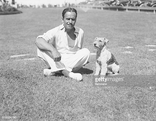 Actor Douglas Fairbanks is shown outdors, with his dog.