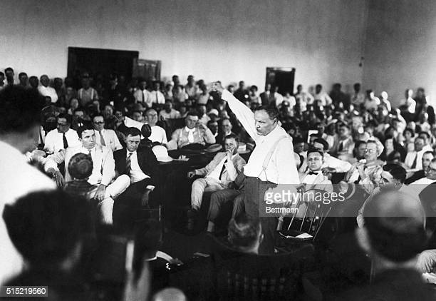 1925Attorney Clarence Darrow raises his fist while making a speech at the Scopes Trial