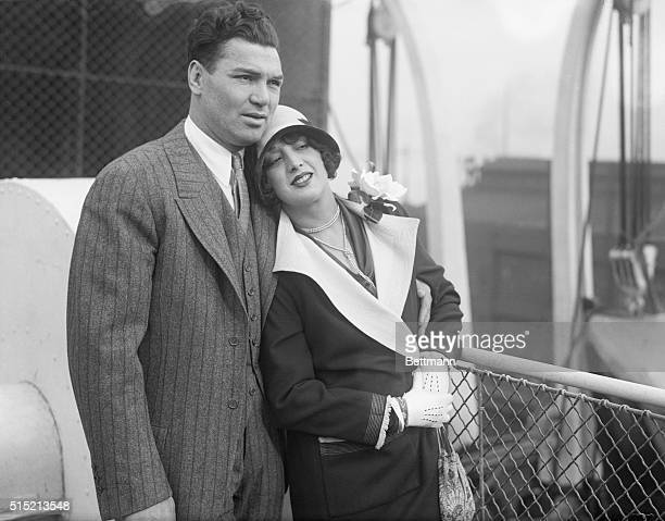Jack Dempsey and his wife, Hannah, are shown sailing on their honeymoon.