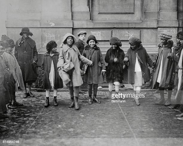 Photo of a group of young Africam-American girls playing after school in Harlem.