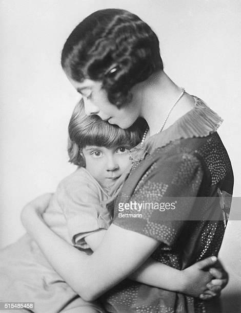 Mrs AA Milne hugging her son Christopher Robin