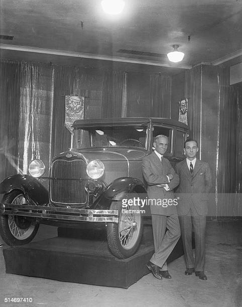 Henry Ford Full length pose with son, Edsel, standing in front of a new model Ford.