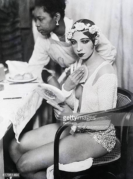 1928Vienna Austria Josephine Baker getting ready in her dressing room She is depicted putting on makeup looking into a mirror BPAII