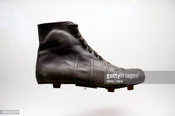 A 1930era cleat is displayed in the Museum of Football on June 10 2014 in Sao Paulo Brazil The museum is housed inside the famed Pacaembu Stadium and...