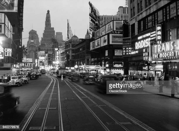 1930s 1934 NIGHT STREET SCENE ON BROADWAY LOOKING SOUTH TO TIMES SQUARE NEW YORK CITY USA