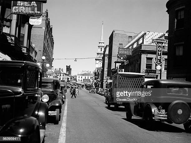 1930s 1935 MAIN STREET SMALL TOWN AUTOMOBILE TRUCK PEDESTRIAN TRAFFIC IN PORTSMOUTH NEW HAMPSHIRE USA