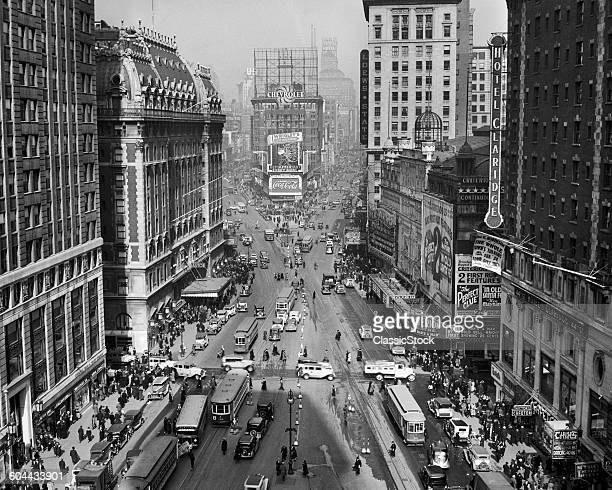 1930s 1935 TIMES SQUARE LOOKING NORTH FROM TIMES TOWER MIDTOWN MANHATTAN PEDESTRIANS TRAFFIC CARS TROLLEYS BUILDINGS MARQUEES