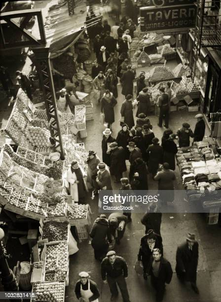 1930s 1937 FRUIT AND VEGETABLE MARKET STANDS ON SIDEWALKS OF WEST SIDE 9TH AVENUE IN HELLS KITCHEN NEW YORK CITY USA